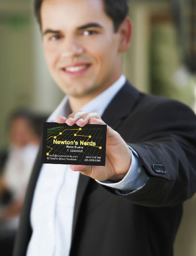 Man shows computer repair business card for Newton's Nerds Sydney.